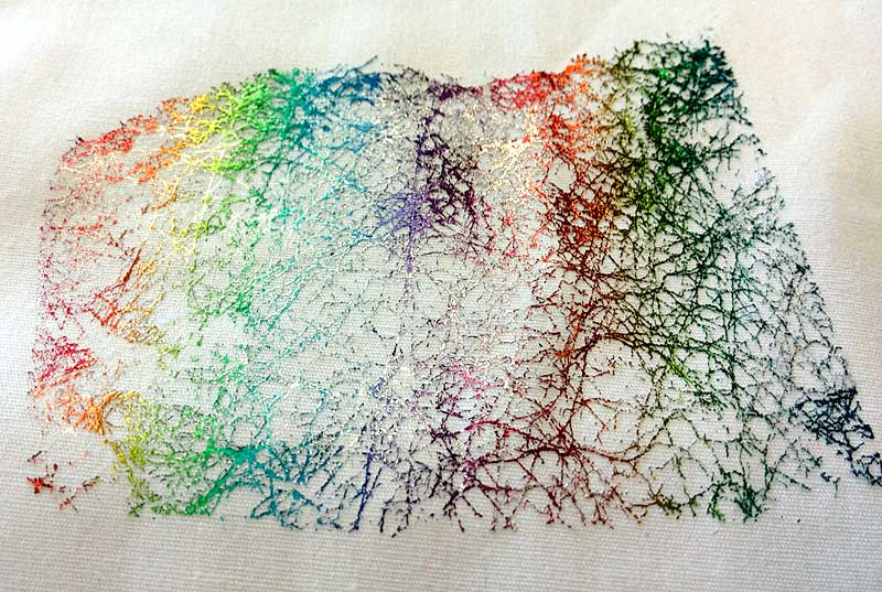 Using Mistyfuse sheer fusible web to apply foil to a fabric swatch