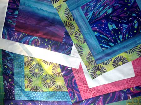An assortment of completed Modern Quilt Squares blocks