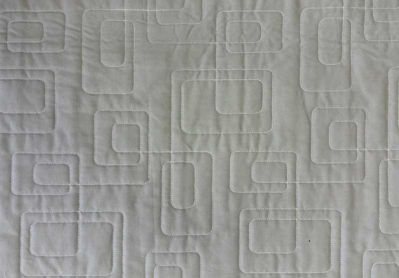 Detail of longarm machine quilting by Mandi Singer-Persell of SewcialStitch