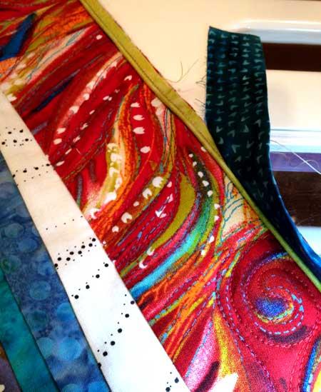 Final touch: lime green piping and a narrow batik binding