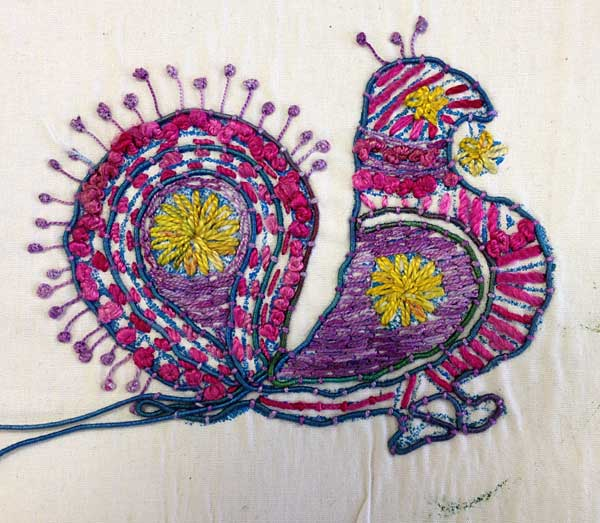 Detail, Block printed fabric accented with hand-stitching by Judy Gula