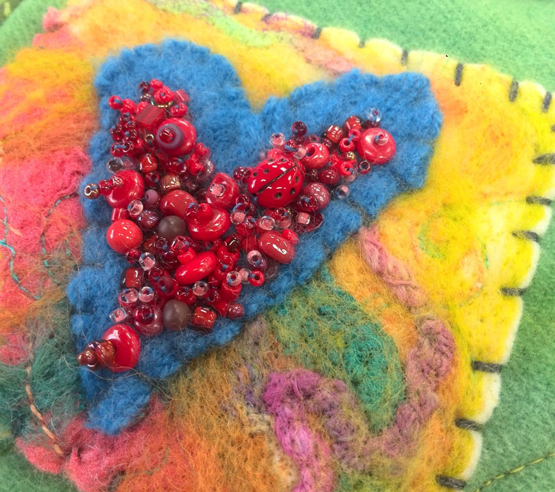 Beaded detail of needlefelted heart by Judy Gula of Artistic Artifacts