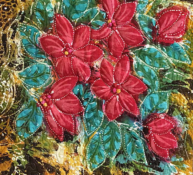 French knots accenting the flower centers of the Hari Agung batik panel