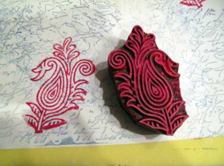 Paisley block stamped in red