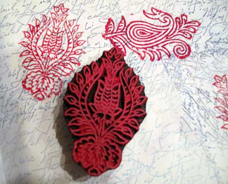 Another paisley block stamped in shades of red