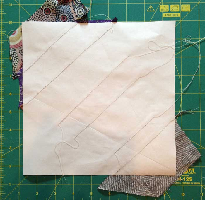 Stitching lines show on the reverse of the paper template