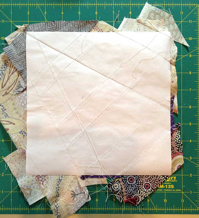The reverse of a completed quarter block string pieced by Judy Gula