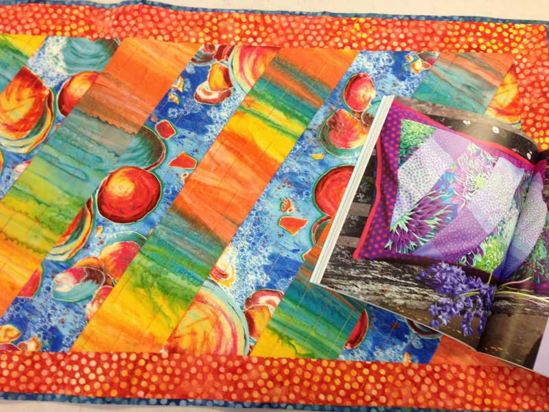 Christine Vinh's table runner and the Kaffe Fassett project that inspired it