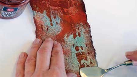 Applying additional Rusty Paper with palette knife