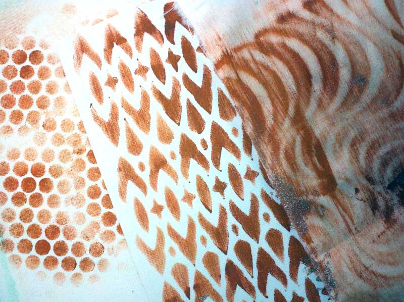 Fabrics stenciled with Rusty Paper