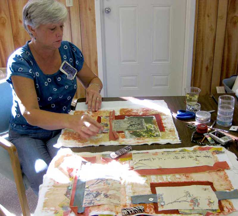 Ruth Chandler at work designing her fiber collage art quilts