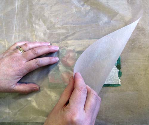 Sprayed paper and fabric sandwiched between non-stick craft sheets
