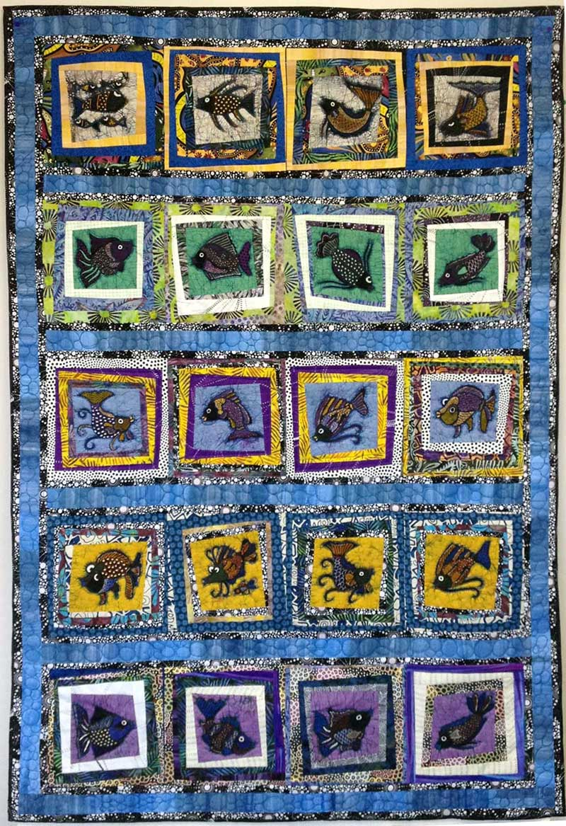 School of Fish quilt by Judy Gula, included in Colorful Batik Panel Quilts by Judy Gula