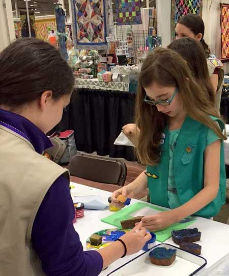 Girl Scout volunteers block printing