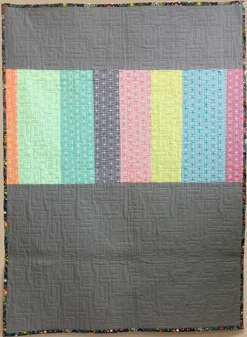 The back of the Squared Elements modern quilt by Christine Vinh of StitchesnQuilts in progress