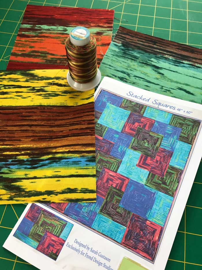 Materials to create a Stacked Squares art quilt
