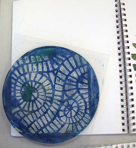 paint-loaded Gel Printing Plate placed on journal page