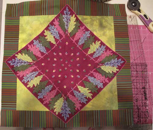 Hankie points overlap the striped border fabric