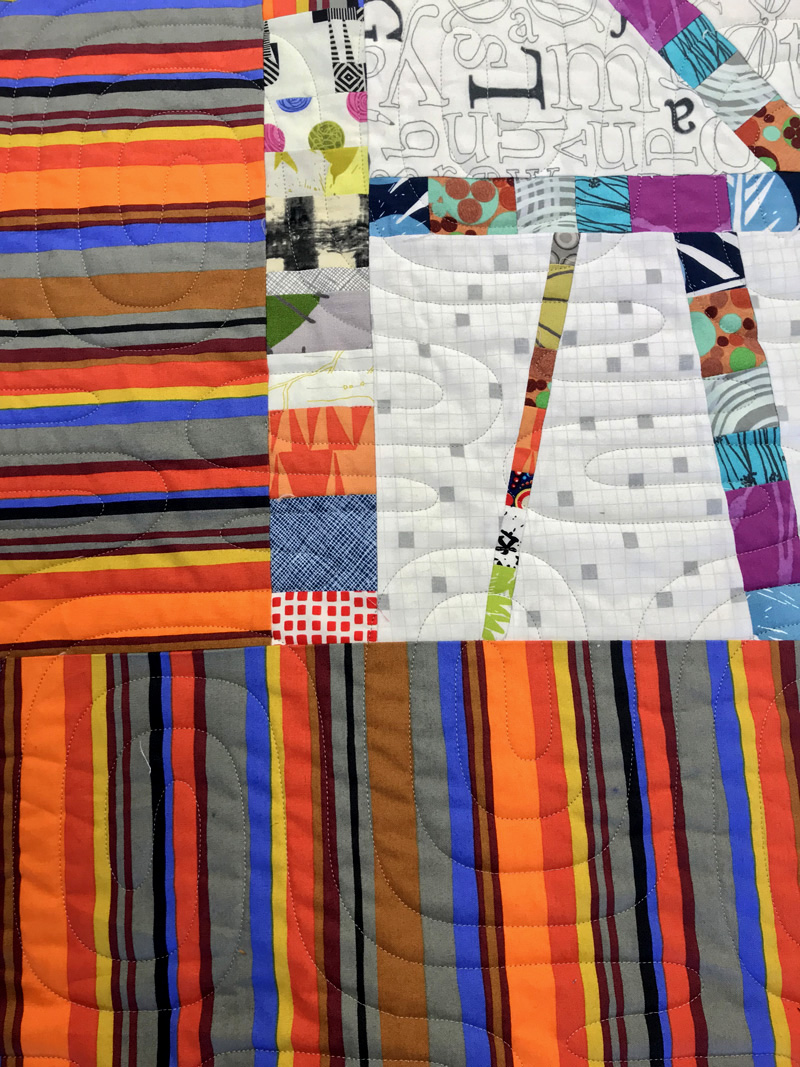 Striped border accents the improv blocks