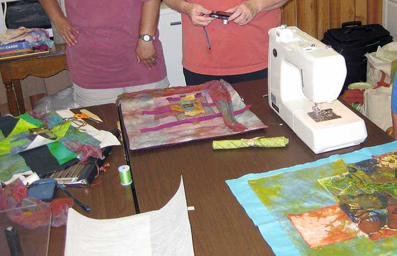 Students beginning to design their collaged art quilts