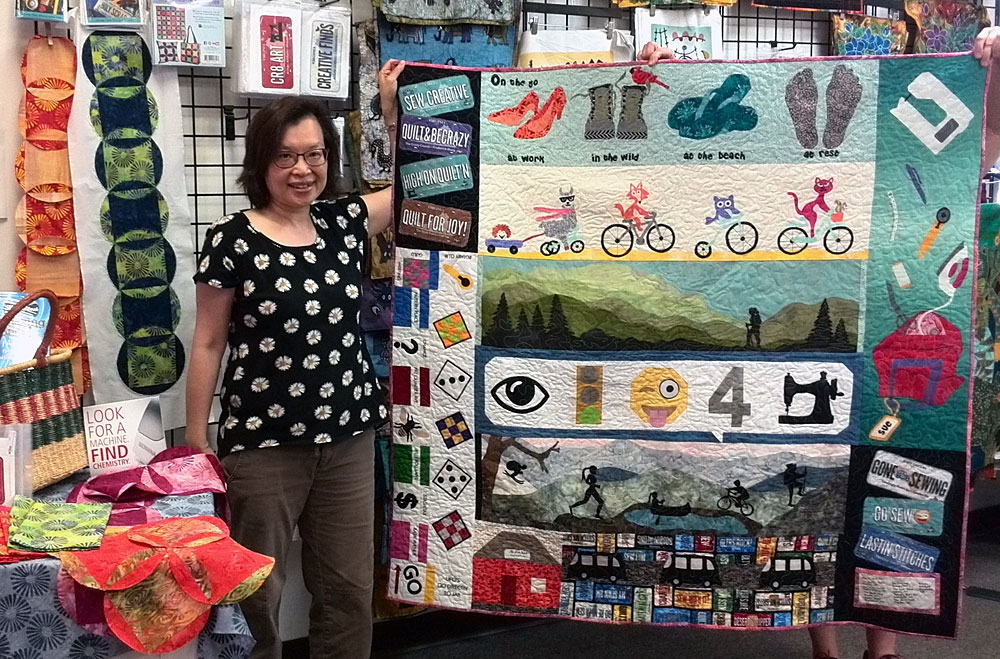 Sue Lee with her 2017 Row by Row Experience quilt, the prize winner at Artistic Artifacts