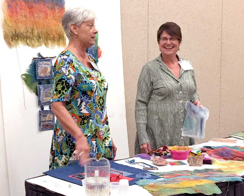 Ruth Chandler and Liz Kettle demonstrating how to create Silk Fusion