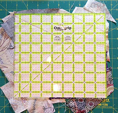 Using a square ruler to trim the quarter block