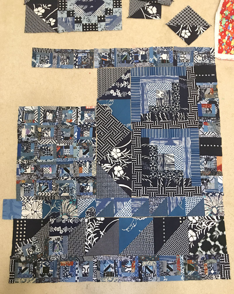 Puzzle like assembly, Virgina's Quilt by Judy Gula with contributions from Virginia Aribe
