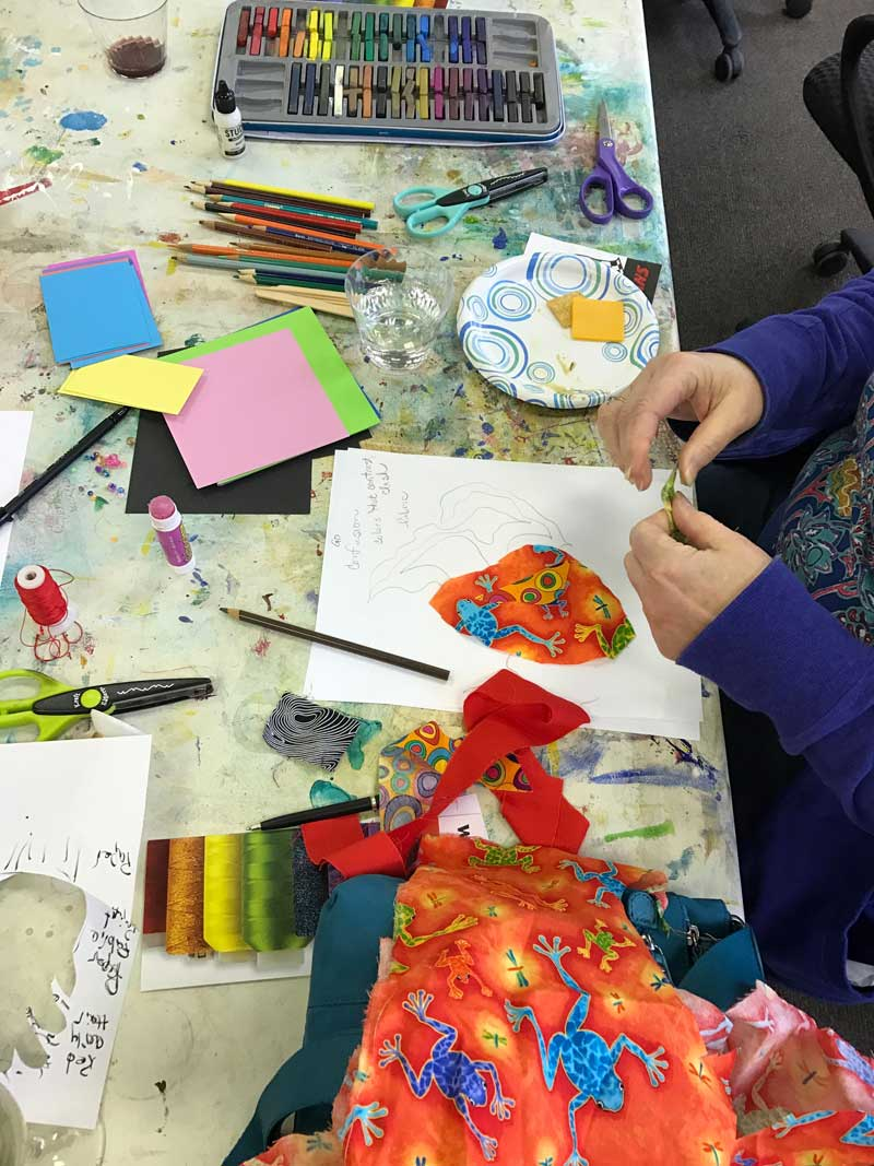 Cutting paper and fabric and using a variety of color tools during the Finding Your Voice lecture/class with Kay Capps Cross