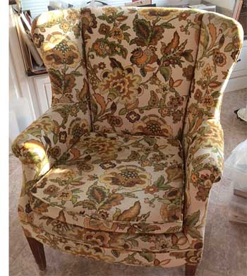 The before view of wing chair owned by Ellen Taylor of Arlington, VA