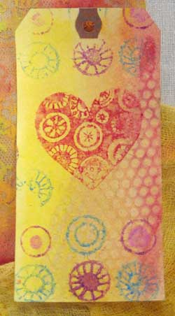 Tag colored with Gelatos and stamped using wooden printing blocks