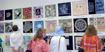 Viewing the Arts & Old Lace art quilt exhibit at Artistic Artifacts