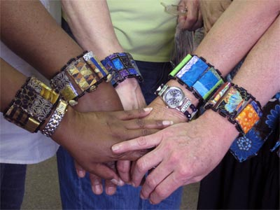 Artistic Artifacts students show off newly made bamboo bracelets