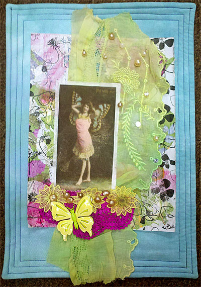 Butterfly Ladyby Judy Gula, an example of an embellished collage art quilt