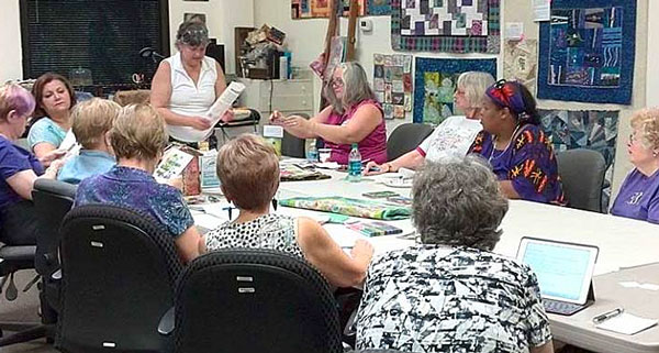"Artistic Artifacts owner Judy Gula (standing) leading a session of ""How Do I..."""